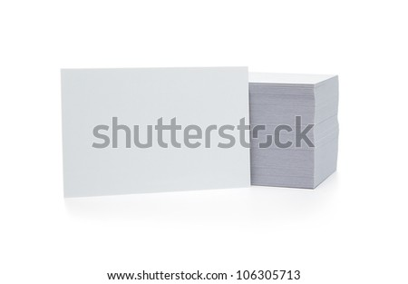 Stack of blank business cards isolated on white background with copy space - stock photo