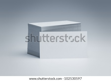 Stack of blank business cards over gray background with copy space - stock photo