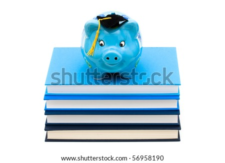 Stack of blue books with a piggy bank isolated on white, Costs of an education - stock photo