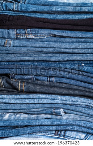Stack of blue jeans background, Close up - stock photo