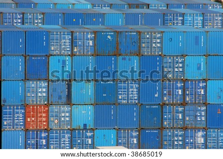 Stack of blue sea containers in an international port  container shipping - stock photo
