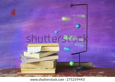 stack of book and a mobile, motion blur, thinking concept - stock photo