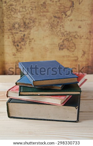 stack of book on wooden table - stock photo