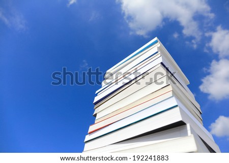 Stack Of Books Against Blue Sky - stock photo