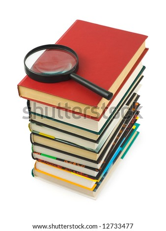 Stack of books and magnifying glass isolated on white background - stock photo