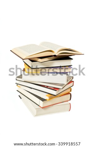 Stack of books and one open book on white background - stock photo