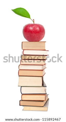 Stack of books and red apple - stock photo