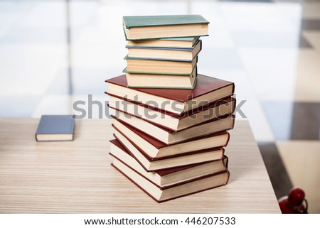 Stack of books arranged the office desk - stock photo