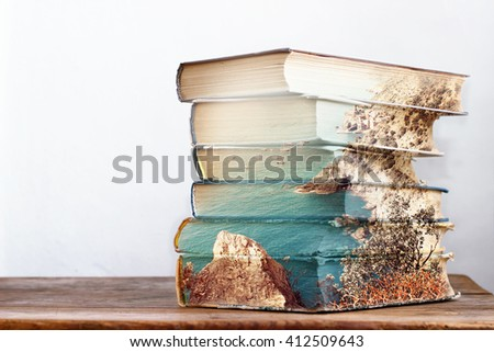 Stack of books. Double exposure effect. - stock photo