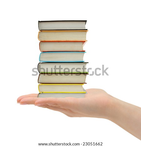 Stack of books in hand isolated on white background - stock photo