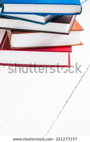 stack of books lying on white table. - stock photo