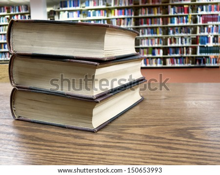 Stack of Books on a Table in a Library - stock photo