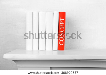 Stack of books on shelf close-up - stock photo