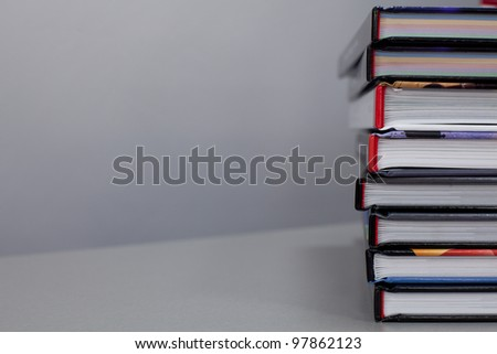 stack of books on the table. with copy-space - stock photo