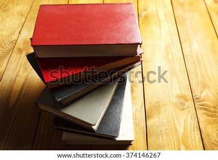 Stack of books on wooden table  - stock photo