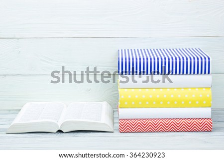 Stack of books on wooden table. Back to school. Copy space - stock photo