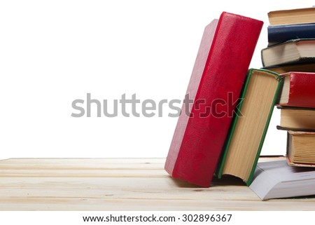 Stack of books on wooden table isolated on white background. Back to school. Copy space - stock photo