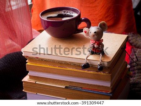 Stack of books with a cup of coffee. Selective focus. With shallow depth of field - stock photo