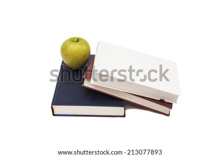 Stack of books with green apple on white background  - stock photo