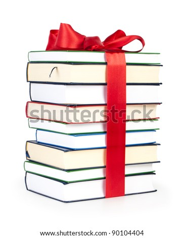 stack of books with ribbon - stock photo