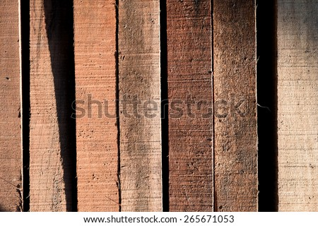 Stack of building Lumber at construction, Wood texture background - stock photo