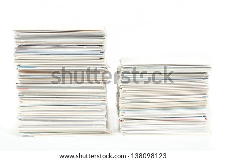 stack of business cards on the table isolated on white - stock photo