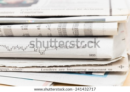 Stack of business newspapers - stock photo