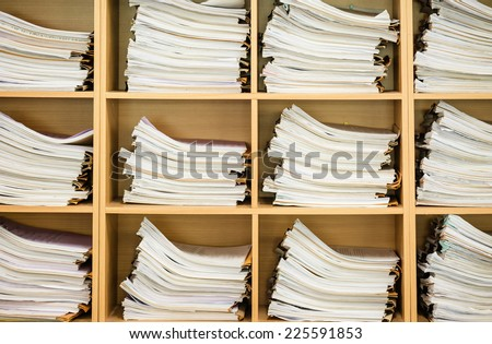 Stack of business papers on the wood shelf   - stock photo