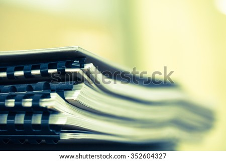 Stack of business papers with black clips - stock photo