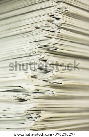 Stack of business report paper files - stock photo
