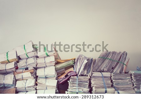 Stack of business report paper files on the document racks,in vintage style - stock photo