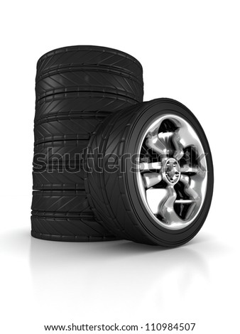 stack of car wheels on white background - stock photo