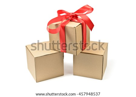 Stack of cardboard boxes with red bow isolated on white - stock photo