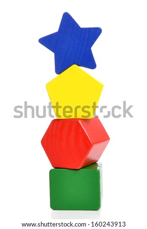 stack of childs wooden blocks isolated on white background - stock photo