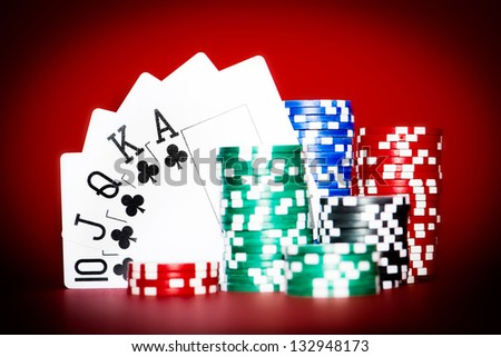 Stack of chips with clubs royal flash - stock photo