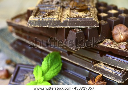 Stack of chocolate bars.Rustic background. - stock photo