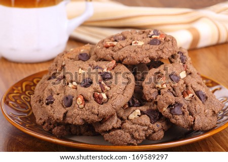 Stack of chocolate chip and nut cookies on a plate - stock photo