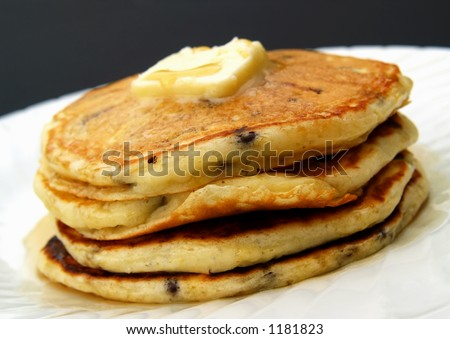 stack of chocolate chip pancakes with butter and syrup - stock photo
