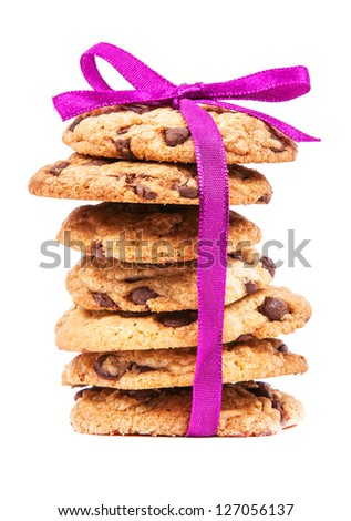 Stack of chocolate cookies tied with pink ribbon isolated on white background - stock photo