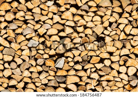 Stack of chopped firewood prepared for winter - stock photo