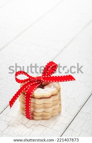 Stack of Christmas cookies wrapped in a red bow - stock photo