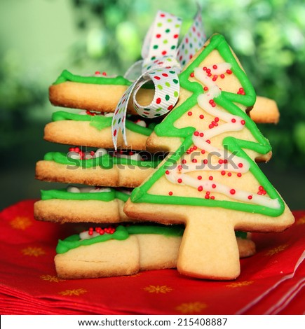 Stack of christmas tree cookies with a ribbon and a cookie - stock photo