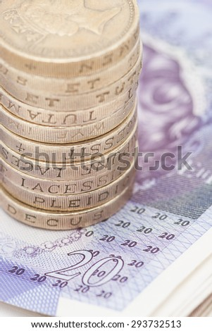 Stack of Coins on Notes - stock photo