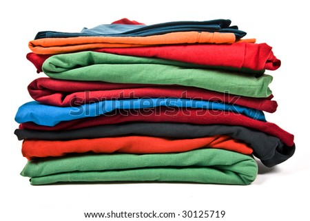 Stack of color clothes isolated on white background - stock photo