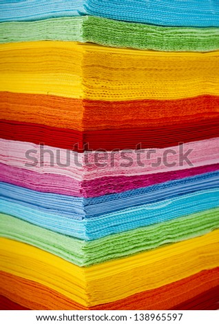 stack of colored strips paper napkins background - stock photo