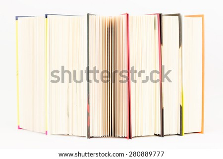 Stack of colorful books are standing on the edge. - stock photo