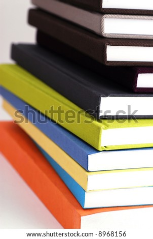 Stack of colorful books, intentional selective focus. - stock photo