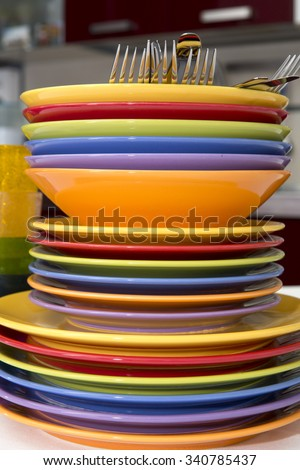 Stack of colorful ceramics plates on the table - stock photo
