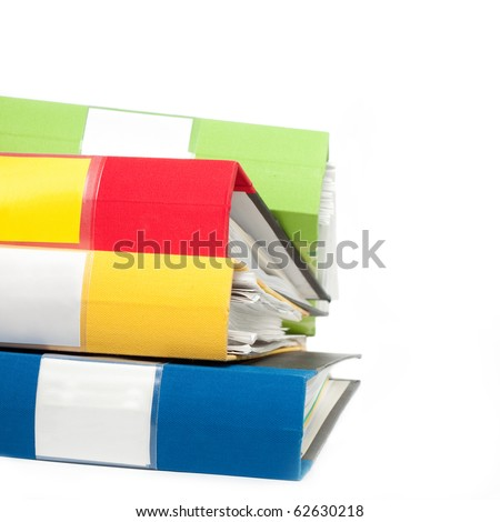Stack of colorful folders full of papers - stock photo
