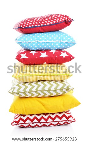 Stack of colorful pillows isolated on white - stock photo